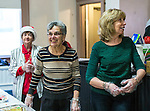 Naugatuck, CT- 25 December 2016-122516CM01-  Volunteers from left, Marge Pierce, of Naugatuck, Mary Oliveira of Naugatuck and Janice White of Watertown serve dessert  during a Christmas Dinner at Saint Michael's Church.  Approximately 400 meals were served, both in-house and delivered said Mike Kelly, director of the event.  He said dinner included fresh  turkey, ham, carrots, turnips, mashed potatoes, homemade desserts, eggnog and a barista serving up various coffee drinks.     Christopher Massa Republican-American