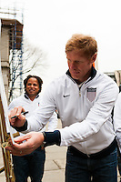 ESPN analyst and former men's national team defender Alexi Lalas signs a document honoring the founding of the US Soccer Federation at a press conference honoring the centennial of U. S. Soccer at City Hall in New York, NY, on April 05, 2013.