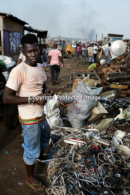 ACCRA, GHANA APRIL 19: A man works at Agbogbloshie, a huge recycling area on April 19, 2015 in central Accra, Ghana. Everything is recycled and bartered here. Most popular are recycled e-waste and car parts.  It has been called an e-waste dumping ground. (Photo by: Per-Anders Pettersson)