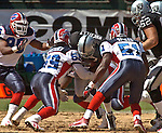 Buffalo Bills linebackers London Fletcher (59) and Takeo Spikes (51) team up to stop Oakland Raiders running back Tyrone Wheatley (47) on Sunday, September 19, 2004, in Oakland, California. The Raiders defeated the Bills 13-10.