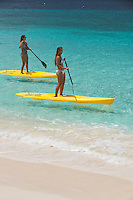 Woman on a stand up paddle board.<br />