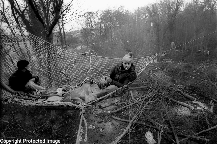 Newbury Bypass.1996.<br /> Activists watch as a protest camp is destroyed around them during the clearance of the route of the Newbury Bypass. Over a thousand people were arrested during the attempt by environmentalists to block the construction of the nine mile road.<br /> &copy;Andrew Testa