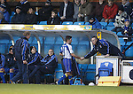 Kilmarnock manager Kenny Shiels shakes the hand of substitute Lee Johnston
