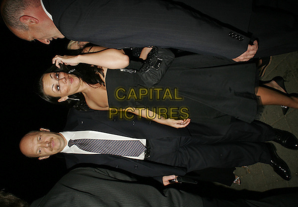 MARTINE McCUTCHEON .Leaving the Berkeley Square Ball, Berkeley Square, .London, July 19th 2005..full length black strapless dress hair over face funny.Ref: SW.www.capitalpictures.com.sales@capitalpictures.com.©Stephen Walters/Capital Pictures.