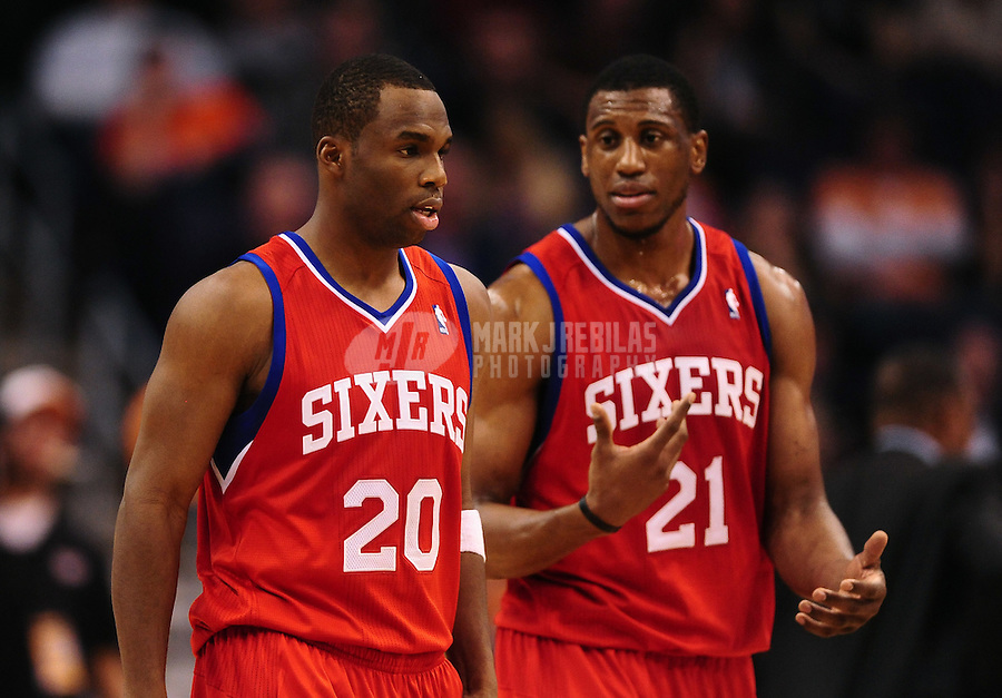 Dec. 28, 2011; Phoenix, AZ, USA; Philadelphia 76ers teammates Jodie Meeks (20) and Thaddeus Young (21) during game against the Phoenix Suns at the US Airways Center. The 76ers defeated the Suns 103-83. Mandatory Credit: Mark J. Rebilas-USA TODAY Sports