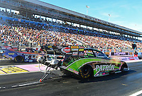 Oct. 26, 2012; Las Vegas, NV, USA: NHRA funny car driver Alexis DeJoria during qualifying for the Big O Tires Nationals at The Strip in Las Vegas. Mandatory Credit: Mark J. Rebilas-