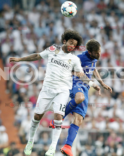 Real Madrid's Marcelo Vieira (l) and Juventus' Claudio Marchisio during Champions League 2014/2015 Semi-finals 2nd leg match.May 13,2015. (ALTERPHOTOS/Acero) /NortePhoto.COM
