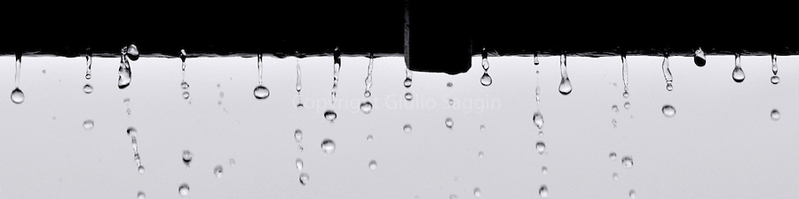Droplets of water cascade off the edge of a roof during a rainstorm in the Brisbane suburb of Upper Brookfield.