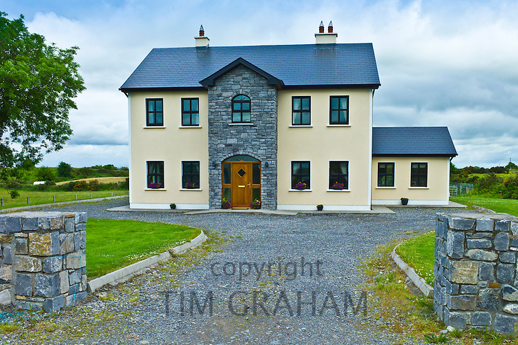 New modern house, typical of extensive new development in Ireland, at Curragh West, County Galway, Ireland
