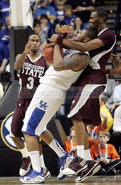 Freshman forward DeMarcus Cousins fights for the ball in the second half of UK's win 75-74 over Mississippi State  Bridgestone Arena in the SEC Finals on Sunday, March 14, 2010. Photo by Britney McIntosh | Staff