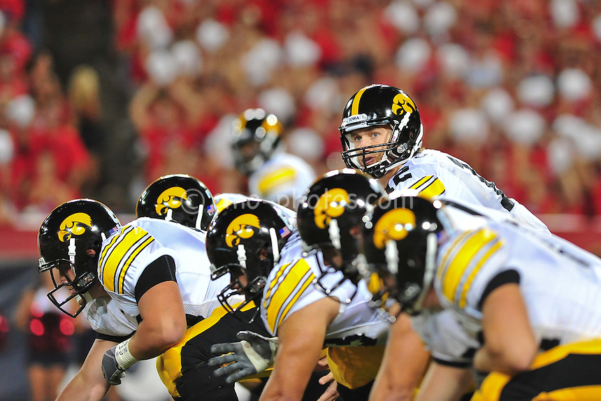 Sept 18, 2010; Tucson, AZ, USA; Iowa Hawkeyes quarterback Ricky Stanzi (12) looks out over his offensive line prior to a play in the 1st quarter of a game at Arizona Stadium.  Arizona won the game 34-27.