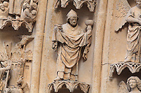 Statue of an unknown man  wearing a mitre and holding a cup, on one of the left-hand archivolts of the tympanum of the South portal or St Honore portal on the South transept of the Basilique Cathedrale Notre-Dame d'Amiens or Cathedral Basilica of Our Lady of Amiens, built 1220-70 in Gothic style, Amiens, Picardy, France. St Honore or Honoratus was the 7th bishop of Amiens who lived in the 6th century AD. Amiens Cathedral was listed as a UNESCO World Heritage Site in 1981. Picture by Manuel Cohen