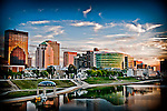 Bright Art-like image of Dayton Ohio skyline. Shows the river and buildings of downtown. Five Rivers Metro Park Riverscape in foreground.