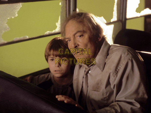 "Twelve year-old Jason Blanchard (Myles Jeffrey) and auctioneer Peter Crane (Stacy Keach) find comfort in one another as a violent hailstorm blasts out the windows of their bus in the tense and gripping PAX original movie, ñFrozen Impact."" .Filmstill - Editorial Use Only.Ref: FB.sales@capitalpictures.com.www.capitalpictures.com.Supplied by Capital Pictures.."