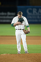 Greensboro Grasshoppers relief pitcher C.J. Robinson (26) says a prayer behind the mound during the game against the Kannapolis Intimidators at NewBridge Bank Park on July 7, 2016 in Greensboro, North Carolina.  The Dash defeated the Pelicans 13-9.  (Brian Westerholt/Four Seam Images)