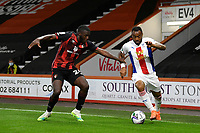Jordan Ayew of Crystal Palace is held by Nnamdi Ofoborh of Bournemouth during AFC Bournemouth vs Crystal Palace, Carabao Cup Football at the Vitality Stadium on 15th September 2020
