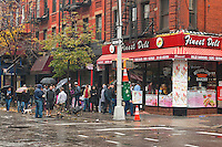 New York, NY -  30 October 2012 New Yorkers queue up for food outside a Bleecker Street deli, one of the few markets open during Hurricane Sandy.
