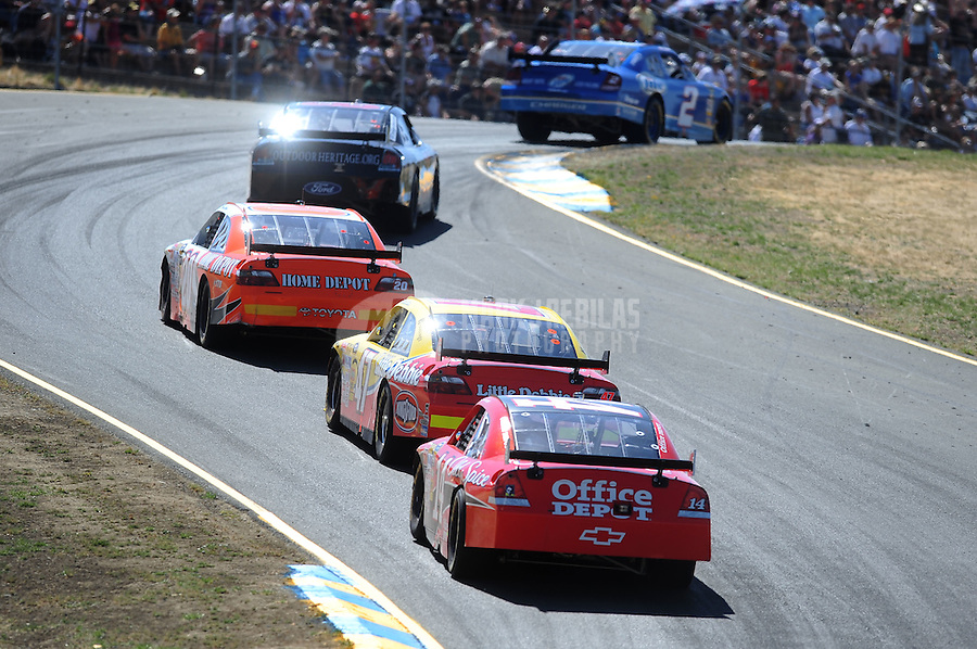 Jun. 21, 2009; Sonoma, CA, USA; NASCAR Sprint Cup Series drivers race through turn three during the SaveMart 350 at Infineon Raceway. Mandatory Credit: Mark J. Rebilas-