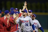 Rowdy Tellez (34) of the Buffalo Bisons slaps hands with his teammates following their win over the Charlotte Knights at BB&T BallPark on July 24, 2019 in Charlotte, North Carolina. The Bisons defeated the Knights 8-4. (Brian Westerholt/Four Seam Images)