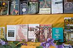Religious, spiritual books on display in bookshop window, Glastonbury, Somerset, England