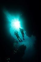 Scuba diver silhouettes<br /> Spook Channel<br /> Roatan<br /> Honduras