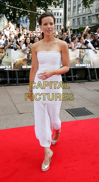"KATE BECKINSALE.Leaving the UK premiere of ""Die Hard 4.0: Live Free or Die Hard"" at the Empire Leicester Square, London, England..June 20th, 2007.full length white strapless dress gold platform shoes .CAP/CAM.©Andre Camara/Capital Pictures"
