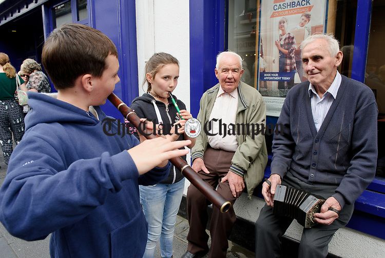 Aaron O Gorman, Cavan, Misha Mc Creesh of Killimer, Tommy Sullivan, Kilmaley and Gerald Haugh of Lissycasey enjoy a tune together on O Connell St. during Fleadh Cheoil na hEireann in Ennis. Photograph by John Kelly.