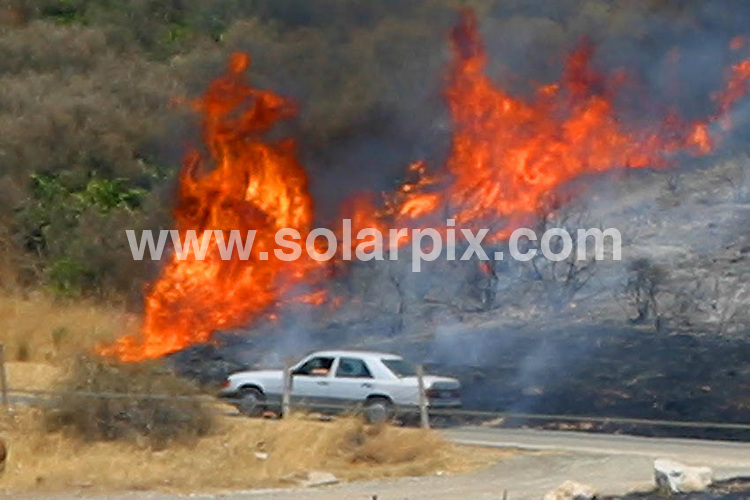 **ALL ROUND PICTURES FROM SOLARPIX.COM**.**WORLDWIDE SYNDICATION RIGHTS**.Brits escaping the UK floods to the safety of their Spanish holiday villas had the realities of global warming brought home to them this week, as bush fires raged across the hills close to the holiday resort of Fuengirola on the Costa del Sol..Brits, Germans and Spanish residents were evacuated as helicopters battled for more than eight hours to extinguish the fire, taking water from local golf course lakes. The thick black smoke could be seen above beaches up to 20 miles away. Luckily there were no casualties and the destruction was kept to the dry grassy hillside..JOB REF:  4366     LCD       DATE:  23.07.07.**MUST CREDIT SOLARPIX.COM OR DOUBLE FEE WILL BE CHARGED* *UNDER NO CIRCUMSTANCES IS THIS IMAGE TO BE REPRODUCED FOR ANY ONLINE EDITION WITHOUT PRIOR PERMISSION*