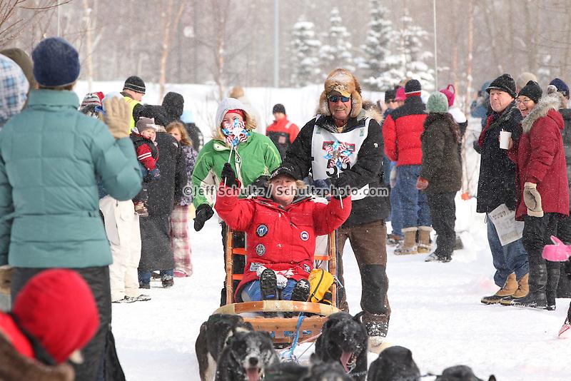 Sonny Lindner Mushes through Bike/ski trail in midtown Anchorage, During the 2012 Iditarod ceremonial start..Britt Coon/Iditarodphotos.com.