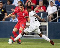 KANSAS CITY, KS - JUNE 26: Francisco Palacios #2 and Daniel Lovitz #16 battle for the ball during a game between United States and Panama at Children's Mercy Park on June 26, 2019 in Kansas City, Kansas.