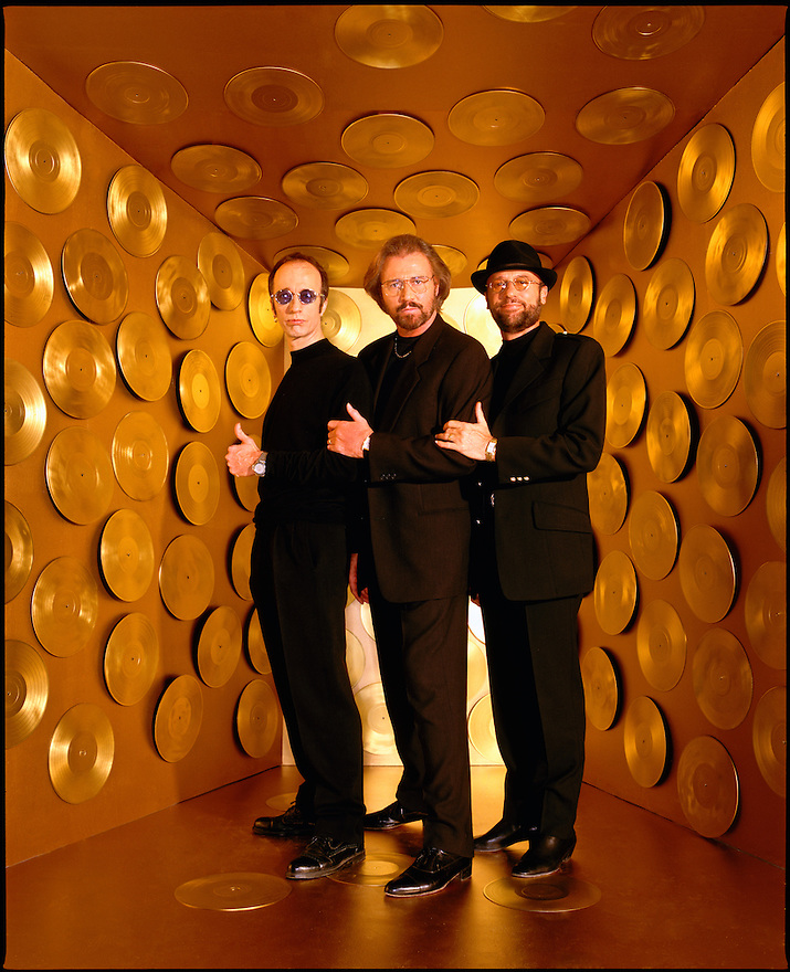 The Bee Gees photographed with Gold Records for Entertainment Weekly (left to right are: Robin, Barry and Maurice Gibb)