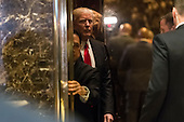 President-elect Donald Trump is seen leaving the lobby of Trump Tower in New York, NY, USA on January 13, 2017.  Credit: Albin Lohr-Jones / Pool via CNP
