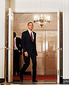 Washington, DC - November 12, 2009 -- United States President Barack Obama enters the Diplomatic Reception Room before making a statement to the press on the economy at the White House, Thursday, November 12, 2009 in Washington, DC. .Credit: Olivier Douliery / Pool via CNP