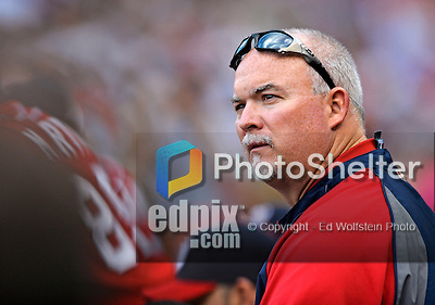 9 June 2012: Washington Nationals trainer Mike McGowan watches from the dugout during a game against the Boston Red Sox at Fenway Park in Boston, MA. The Nationals defeated the Red Sox 4-2 in the second game of their 3-game series. Mandatory Credit: Ed Wolfstein Photo
