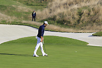 Dustin Johnson Team USA sinks his putt on the 14th green during Friday's Foursomes Matches at the 2018 Ryder Cup 2018, Le Golf National, Ile-de-France, France. 28/09/2018.<br /> Picture Eoin Clarke / Golffile.ie<br /> <br /> All photo usage must carry mandatory copyright credit (© Golffile | Eoin Clarke)