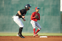 Lakewood BlueClaws second baseman Daniel Brito (21) works to keep Tyler Frost (1) of the Kannapolis Intimidators close to the base during the South Atlantic League game at Kannapolis Intimidators Stadium on July 7, 2018 in Kannapolis, North Carolina. The Intimidators defeated the BlueClaws 4-3 in 10 innings.  (Brian Westerholt/Four Seam Images)