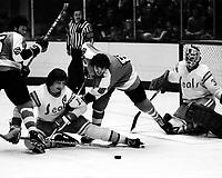 California Golden Seals vs Philadelphia Flyers 1975.<br />Flyer #8 Dave Schultz,  #15 Jim Neilson, and golie Gary Simmons.<br />(photo/Ron Riesterer)