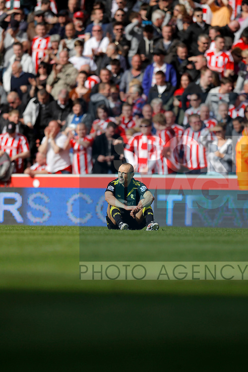Dejection for Martin Petrov of Bolton Wanderers at the end of the game..Barclays Premier League match between Stoke City v Bolton Wanderers at the Britannia Stadium, Stoke on the 13th May 2012. Pic Malcolm Couzens/SPORTIMAGE...