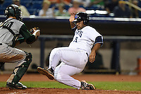 Lake County Captains first baseman Nellie Rodriguez (25) is tagged out sliding into home by Ryan Miller (20) during a game against the Fort Wayne TinCaps on August 21, 2014 at Classic Park in Eastlake, Ohio.  Lake County defeated Fort Wayne 7-8.  (Mike Janes/Four Seam Images)