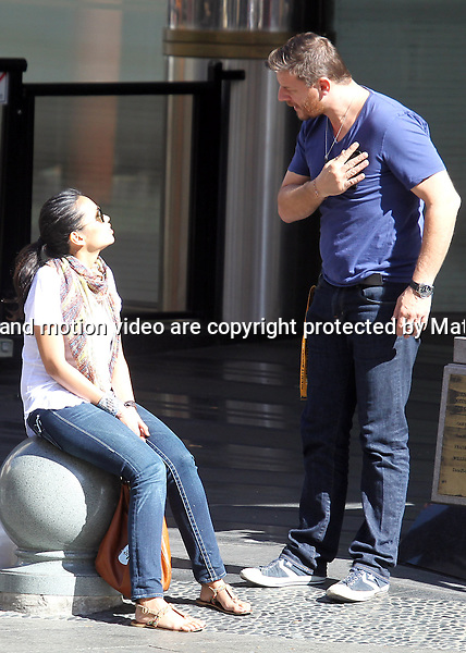 5 MAY 2013 SYDNEY AUSTRALIA..EXCLUSIVE..Manu Feildel pictured with his son Jonti and girlfriend Clarissa in Chinatown after Yum Cha. Jonti and Clarissa waited patiently as Manu took a long phone call. Later they drove to Double Bay for some shopping at Double Bay Clothing Wharehouse and Kids Stuff...*No internet without clearance*.MUST CALL PRIOR TO USE +61 2 9211-1088. Matrix Media Group.Note: All editorial images subject to the following: For editorial use only. Additional clearance required for commercial, wireless, internet or promotional use.Images may not be altered or modified. Matrix Media Group makes no representations or warranties regarding names, trademarks or logos appearing in the images..