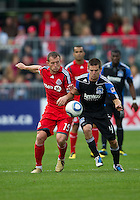 25 September 2010:  Toronto FC forward Chad Barrett #19 and San Jose Earthquakes midfielder Sam Cronin #4 in action during a game between the San Jose Earthquakes and Toronto FC at BMO Field in Toronto..San Jose Earthquakes won 3-2...