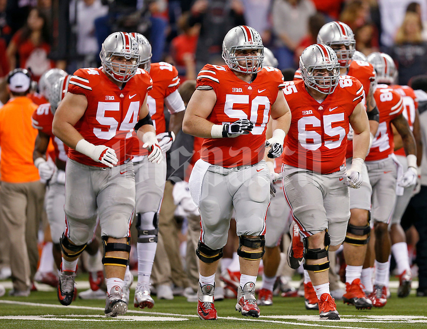 Ohio State Buckeyes offensive lineman Billy Price (54), Ohio State Buckeyes offensive lineman Jacoby Boren (50) and Ohio State Buckeyes offensive lineman Pat Elflein (65) against Wisconsin Badgers in the 2014 Big Ten Football Championship Game at Lucas Oil Stadium in Indianapolis, Ind. on December 6, 2014.  (Dispatch photo by Kyle Robertson)
