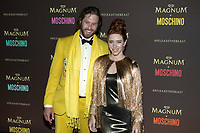 TJ Miller and Kate Gorney arrive at the Magnum X Moschino party during the 70th Annual Cannes Film Festival at Plage l'Ondine in Cannes, France, on 18 May 2017. Photo: Hubert Boesl - NO WIRE SERVICE · Photo: Hubert Boesl/dpa /MediaPunch ***FOR USA ONLY***