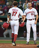 NWA Democrat-Gazette/ANDY SHUPE<br />Arkansas left fielder Luke Bonfield (17) is congratulated at the plate by first baseman Chad Spanberger Friday, March 17, 2017, after hitting a 2-run home run scoring Spanberger during the first inning against Mississippi State at Baum Stadium in Fayetteville. Visit nwadg.com/photos to see more photographs from the game.