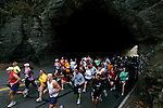 Runners emerge from a tunnel on Kelly Drive during the Philadelphia Marathon in Philadelphia, Pennsylvania on November 19, 2006.