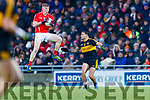 Evan Cronin, East Kerry in action against Michael Burns, Dr Crokes  during the Kerry County Senior Club Football Championship Final match between East Kerry and Dr. Crokes at Austin Stack Park in Tralee, Kerry.