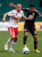 Christian Castillo (12) of D.C. United fights for the ball with Joel Lindpere (20) of the New York Red Bulls at RFK Stadium in Washington, DC.  The New York Red Bulls defeated D.CC United, 2-0.