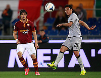 Calcio, Serie A: Roma vs Atalanta. Roma, stadio Olimpico, 12 aprile 2014.<br /> AS Roma defender Dodo', of Brazil, left, and Atalanta midfielder Marcelo Estigarribia, of Paraguay, in action during the Italian Serie A football match between AS Roma and Atalanta at Rome's Olympic stadium, 12 April 2014. AS Roma won 3-1.<br /> UPDATE IMAGES PRESS/Isabella Bonotto