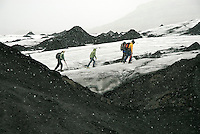 While the average temperature in Reykjavik during Iceland's warmest month is 15 °C, for a few short minutes, I felt like a polar explorer on an uncharted expedition as we walked in single file, avoiding the bottomless crevasses of the Sólheimajökull outlet glacier of the Myrdalsjökull icecap. Moments later, our sudden and dramatic taste of an Icelandic winter passed and our arctic adventure turned back into a comfortable stroll over the ancient lava-stained ice flow.