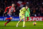Jordi Alba of FC Barcelona (R) in action against Angel Correa of Atletico de Madrid (L) during the La Liga 2018-19 match between Atletico Madrid and FC Barcelona at Wanda Metropolitano on November 24 2018 in Madrid, Spain. Photo by Diego Souto / Power Sport Images